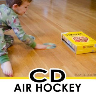 CD AIR HOCKEY: A fun gross motor skills activity for toddlers; easy toddler activity; easy indoor activity