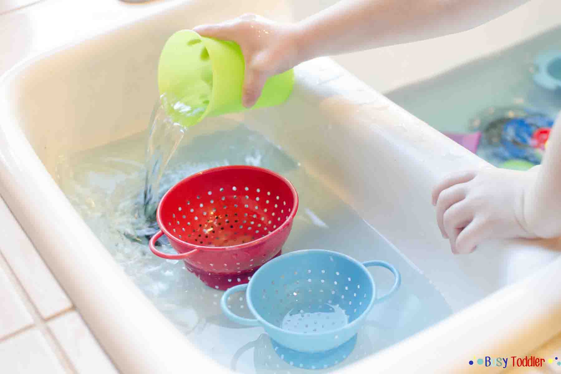 Colander Pour: a kitchen sink activity with water fun.