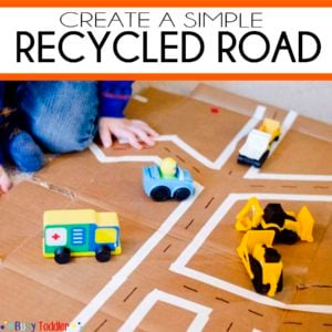 Recycled Road: Create a toddler city using a cardboard box and tape. Let your child's imagination soar in this easy toddler activity.
