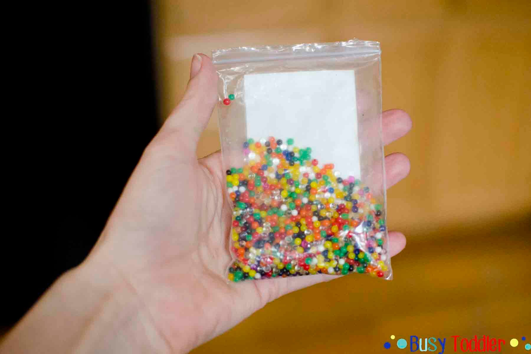 SCOOP AND TRANSFER: A fun toddler activity using water beads