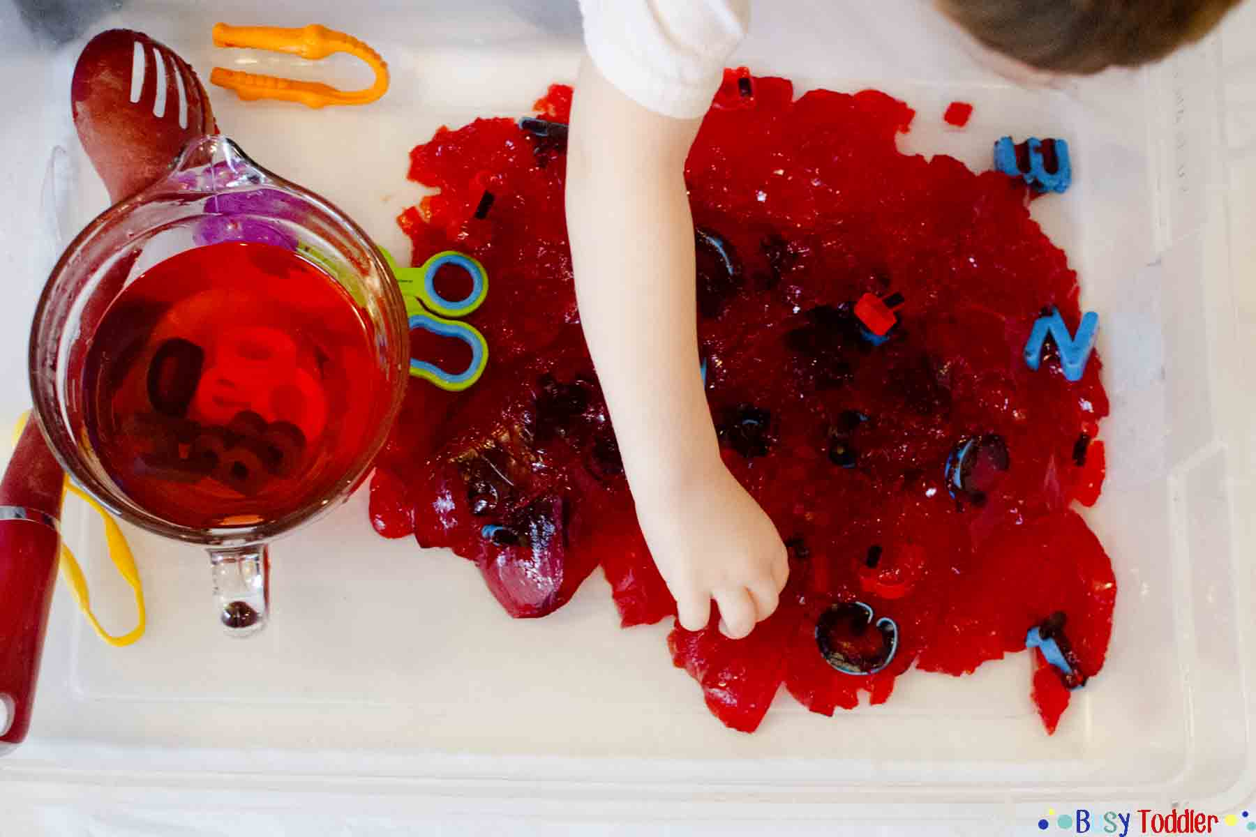 ABC JELLO: An easy toddler activity using alphabet letters and Jello for a fun literacy & sensory experience. A preschool activity and baby activity too.