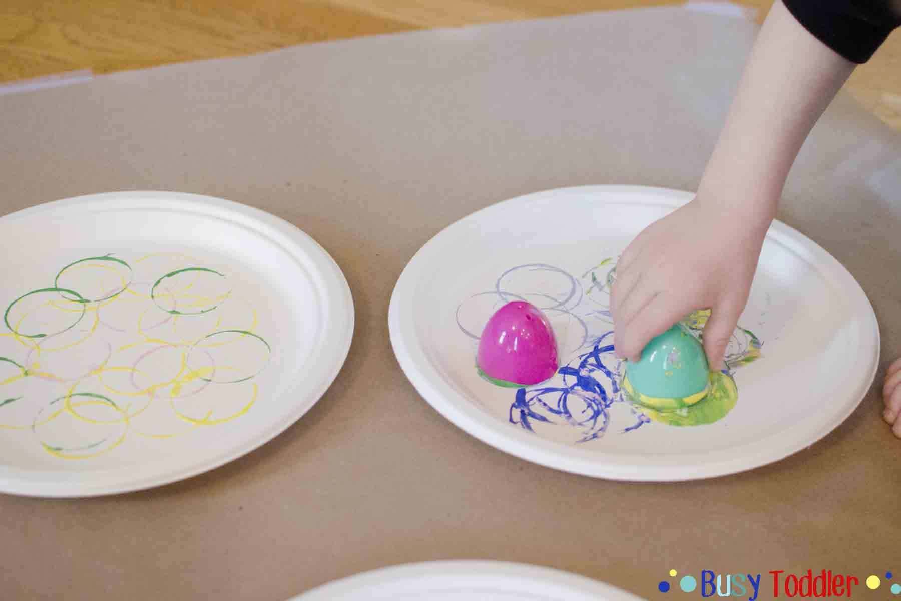 EASTER EGG STAMP ART: An easy toddler activity stamping Easter Egg circles. Turn this cute stamp art into toddler-made place cards for Easter dinner.