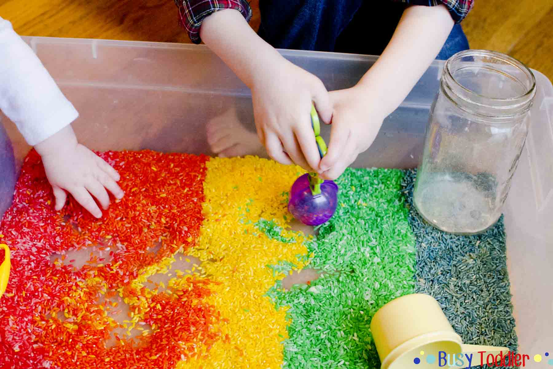 Rainbow rice sensory bin create a simple rice sensory bin using food coloring an