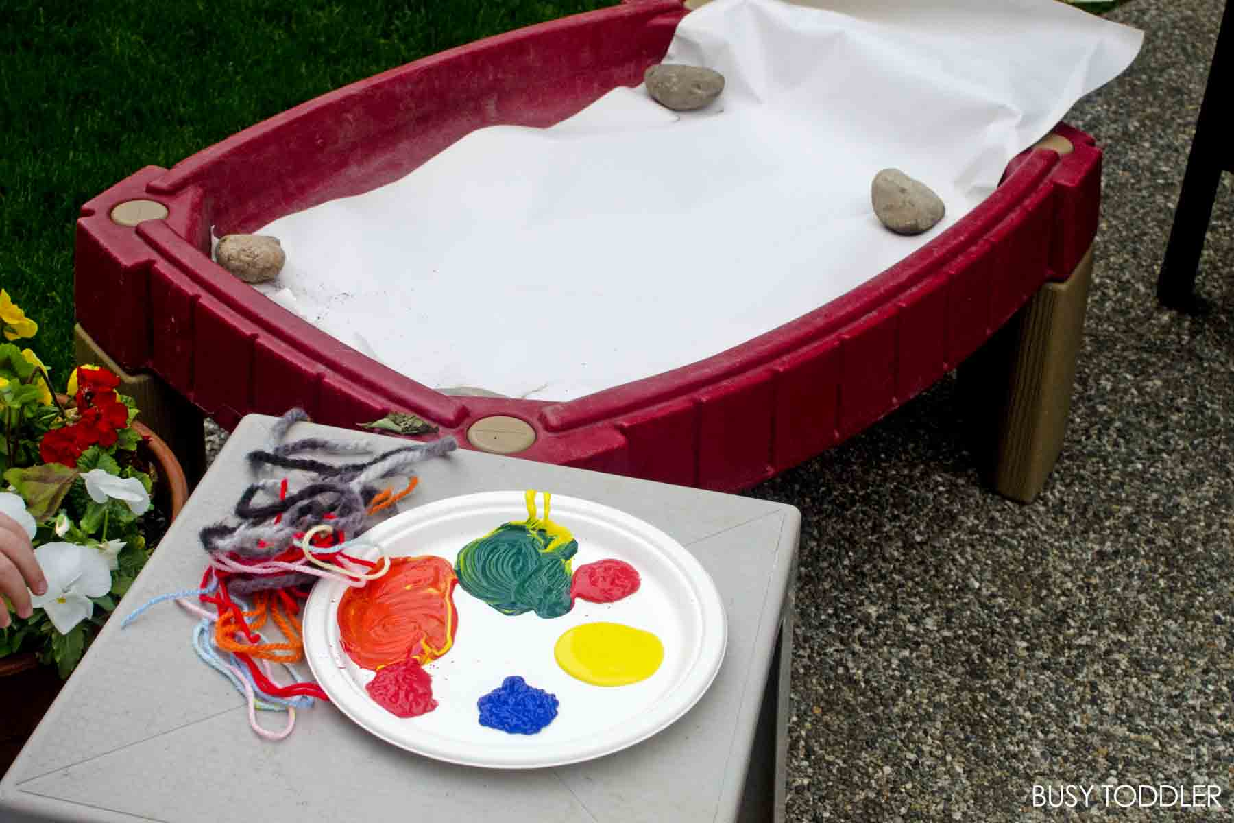 YARN PAINTING:  A fun outdoor process art activity that's perfect for toddlers and preschoolers; easy summer activity; messy art activity