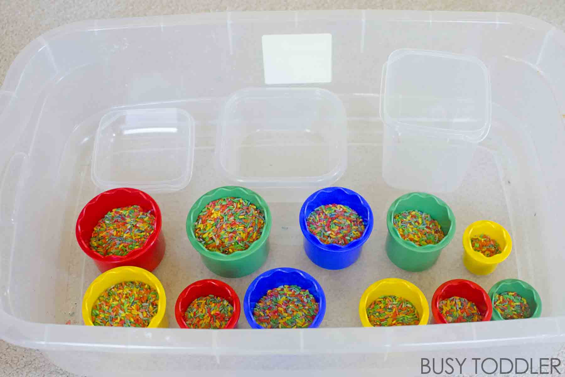 DUMPING STATION:  A fun and easy sensory bin set up for toddlers; especially good for young toddlers; easy toddler activity; a great indoor activity