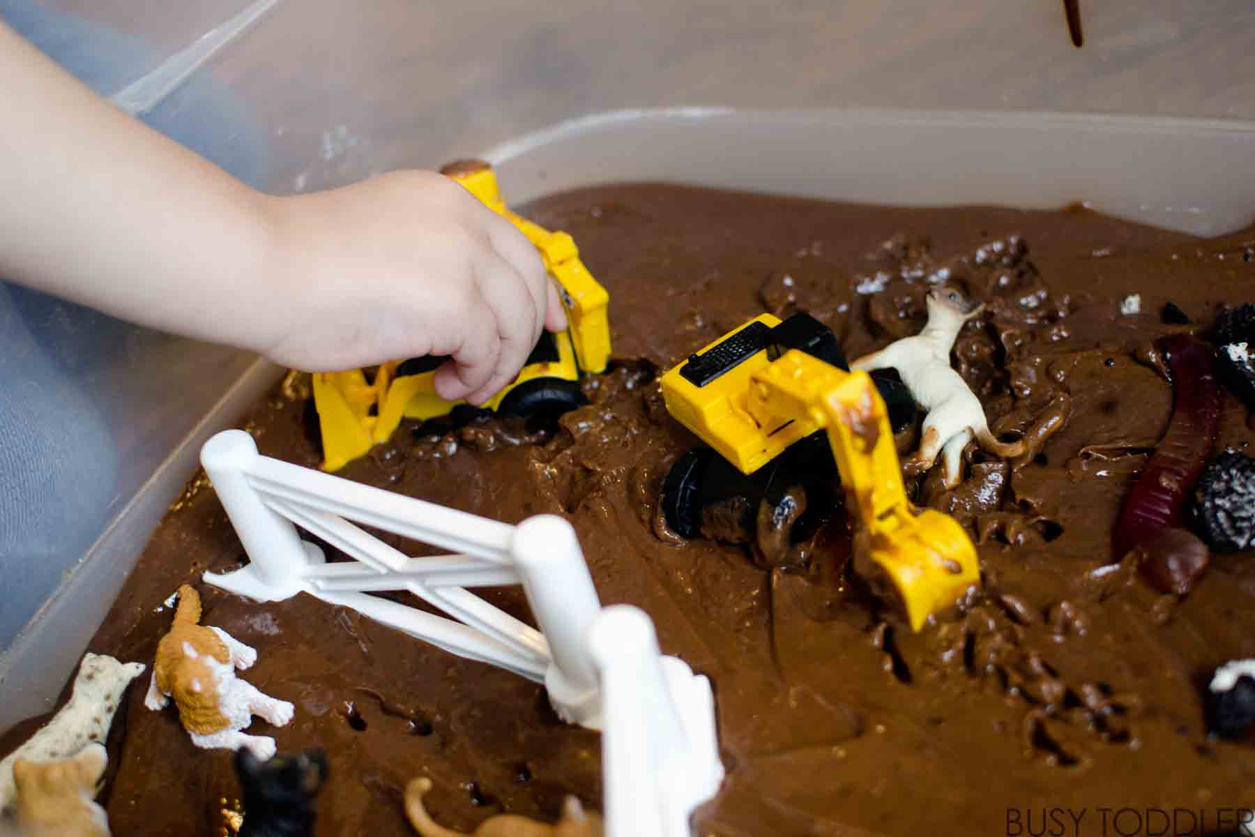 EDIBLE MUD: Have some sticky, yummy fun with this easy toddler activity. Make a messy memory with this fun toddler activity. Enjoy a sensory activity with your toddler.