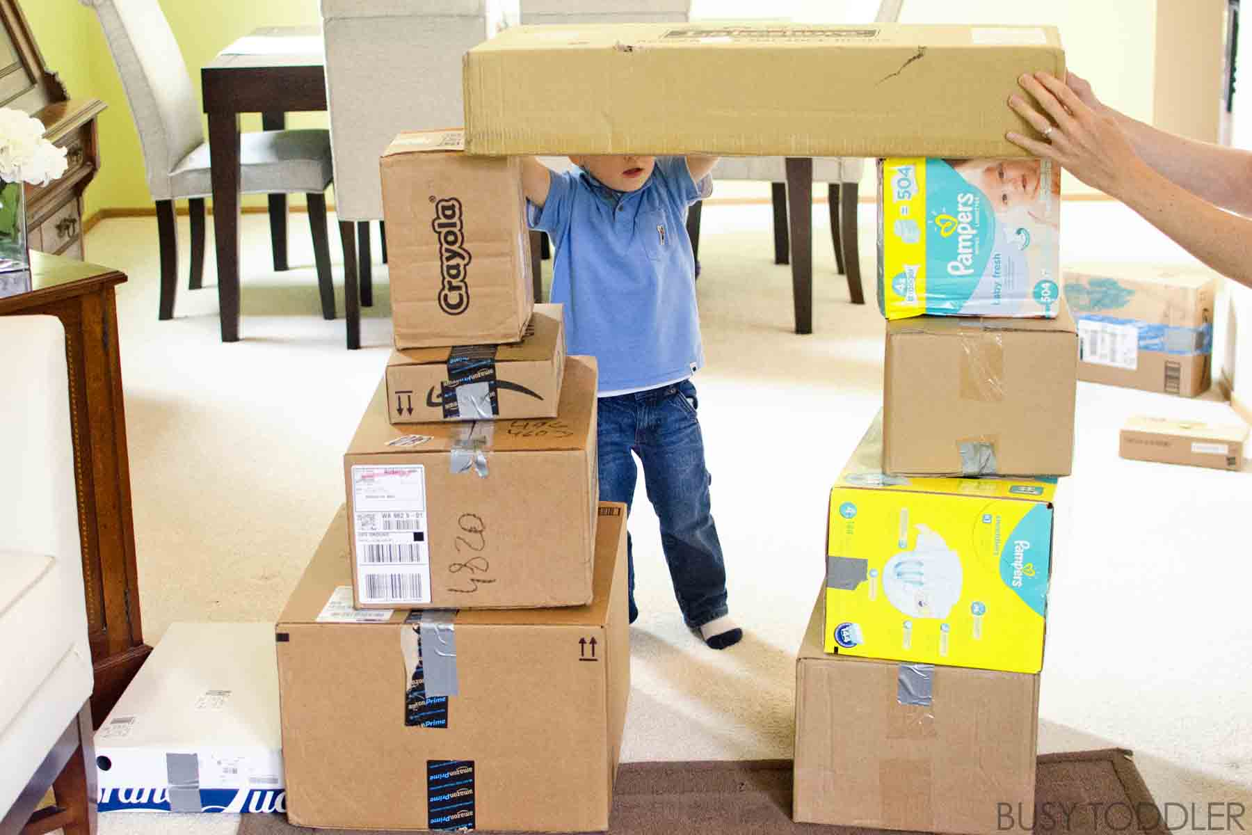 GIANT BUILDING BLOCKS: Create life sized blocks for your toddler in this fun gross motor skills / STEM activity. Toddlers will love creating larger than life buildings, bridges, and tunnels.