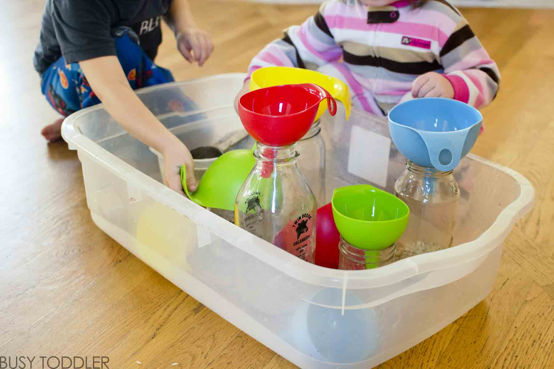 FUNNEL FUN: A simple toddler activity that takes seconds to set up; easy indoor activity for toddlers; toddler life skills activity