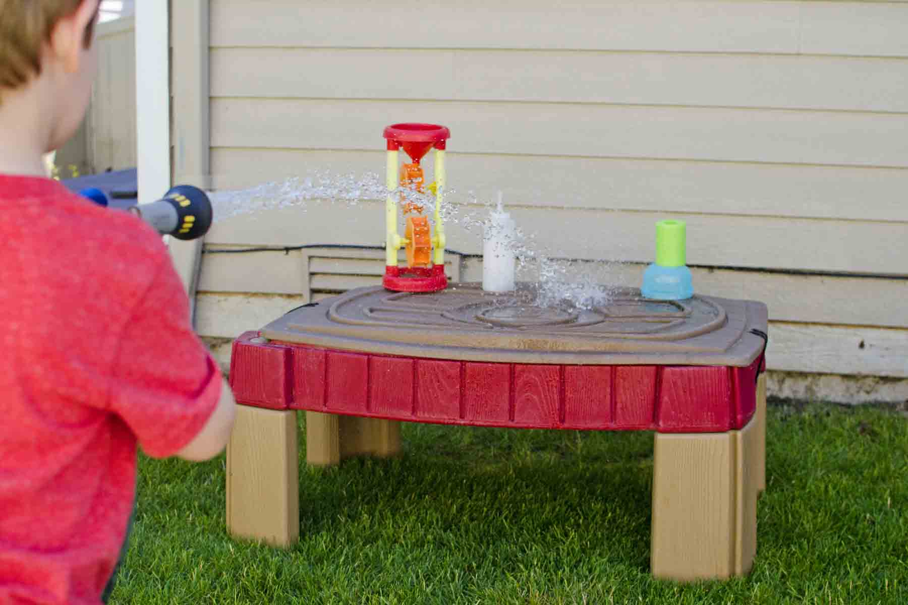 HOSE TARGETS: A simple backyard activity that's just silly fun; a fine motor skills activity for toddlers and preschoolers