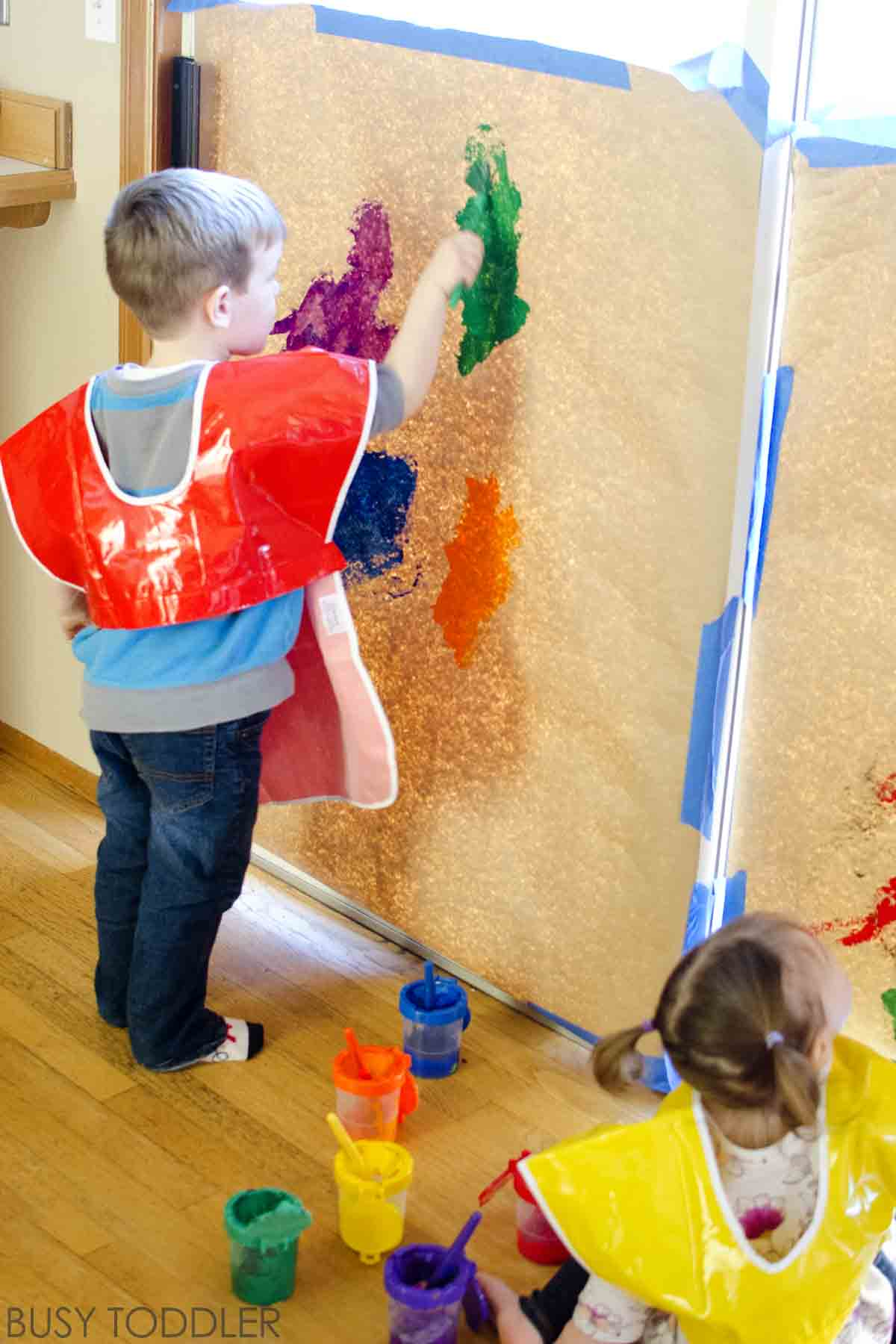 GIANT PAINTING TODDLER ART: What a great toddler activity! An easy indoor toddler activity painting on a huge space; preschool art activity
