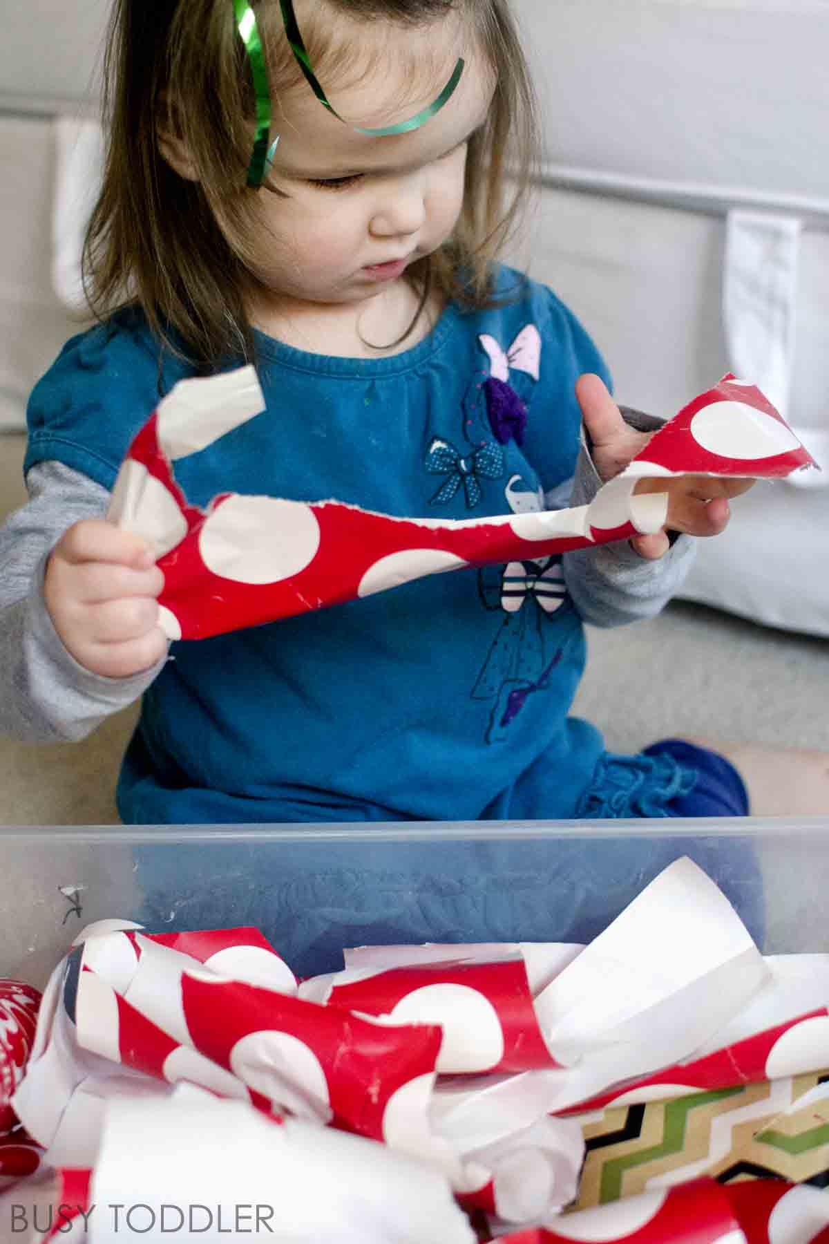 RIPPING PAPER: A fun way to reuse wrapping paper; a simple toddler activity with wrapping paper; fun holiday activity; easy Christmas activity; easy toddler activity