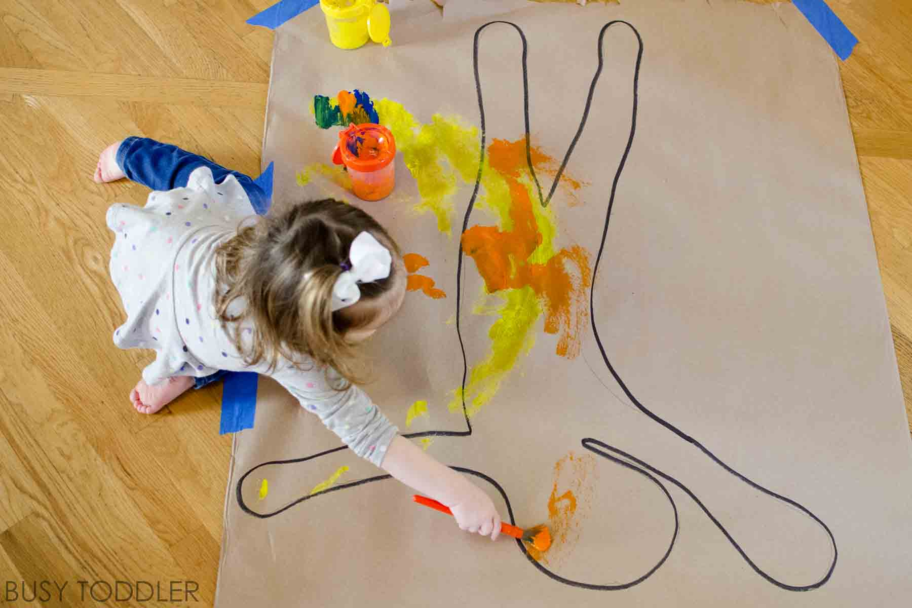 BODY PAINT: A fun process art activity that's perfect for toddlers, preschoolers and kids. Such a perfect indoor activity on a rainy day. This easy indoor activity is so much fun!