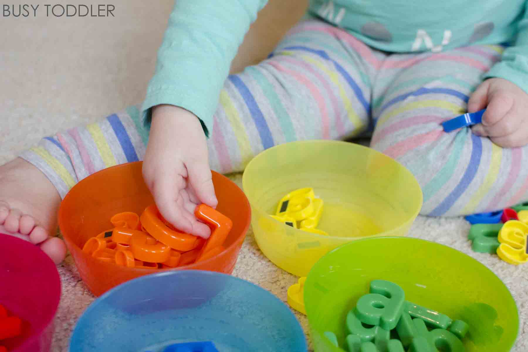 Alphabet Sorting Activity: check out this super easy activity for toddlers and preschoolers. Sorting alphabet letters is a great indoor activity. A math and literacy activity for toddlers.