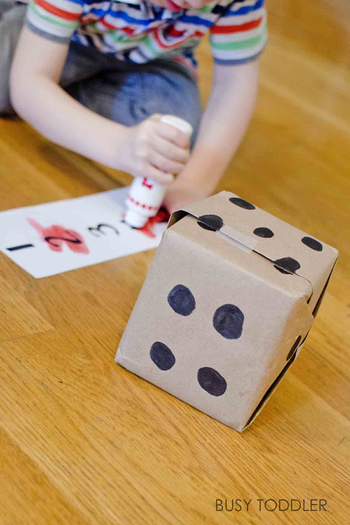ROLL & CROSS: What a fun and easy math game for kids of all ages! This is a perfect number recognition and counting game for toddlers and preschoolers. They will love playing with this homemade dice and racing to cross out the numbers!