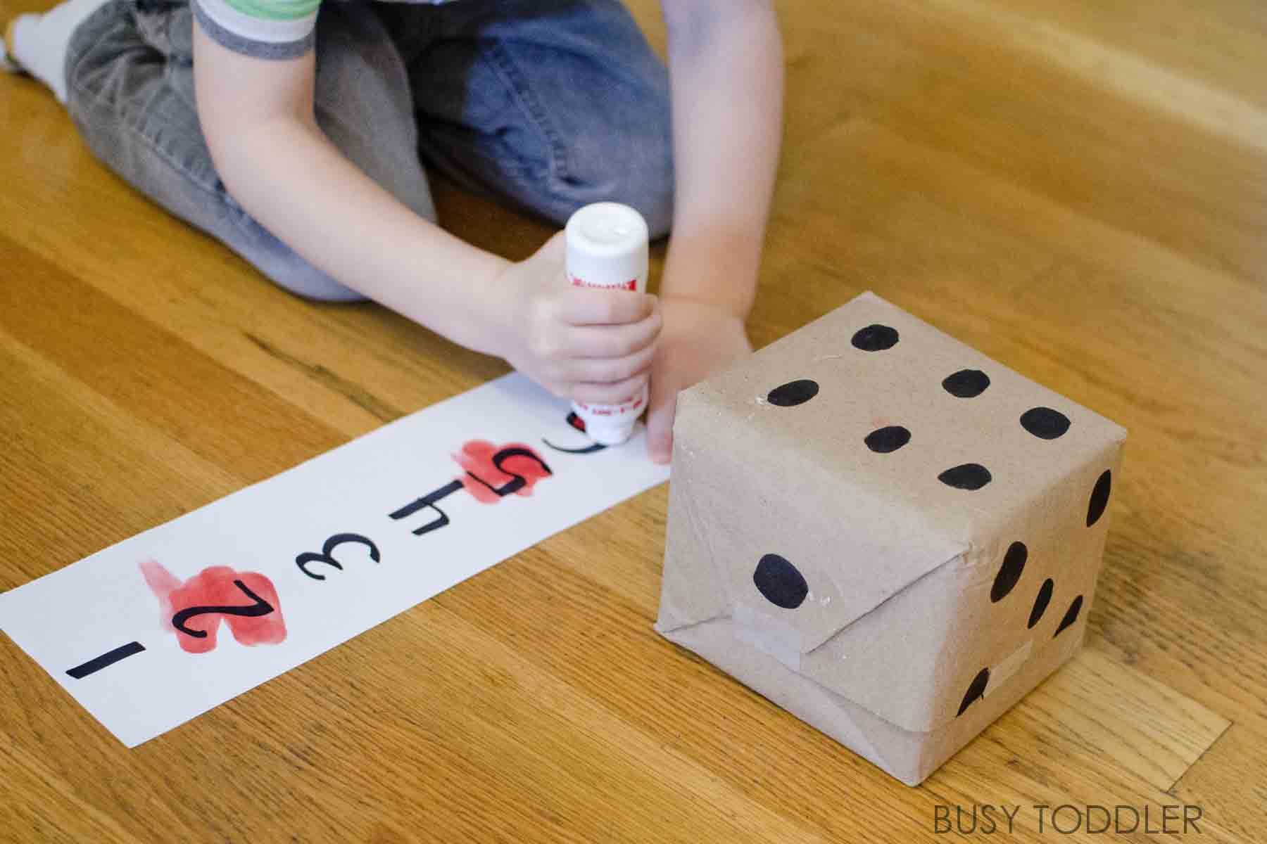 Roll & Cross Math Game - Busy Toddler