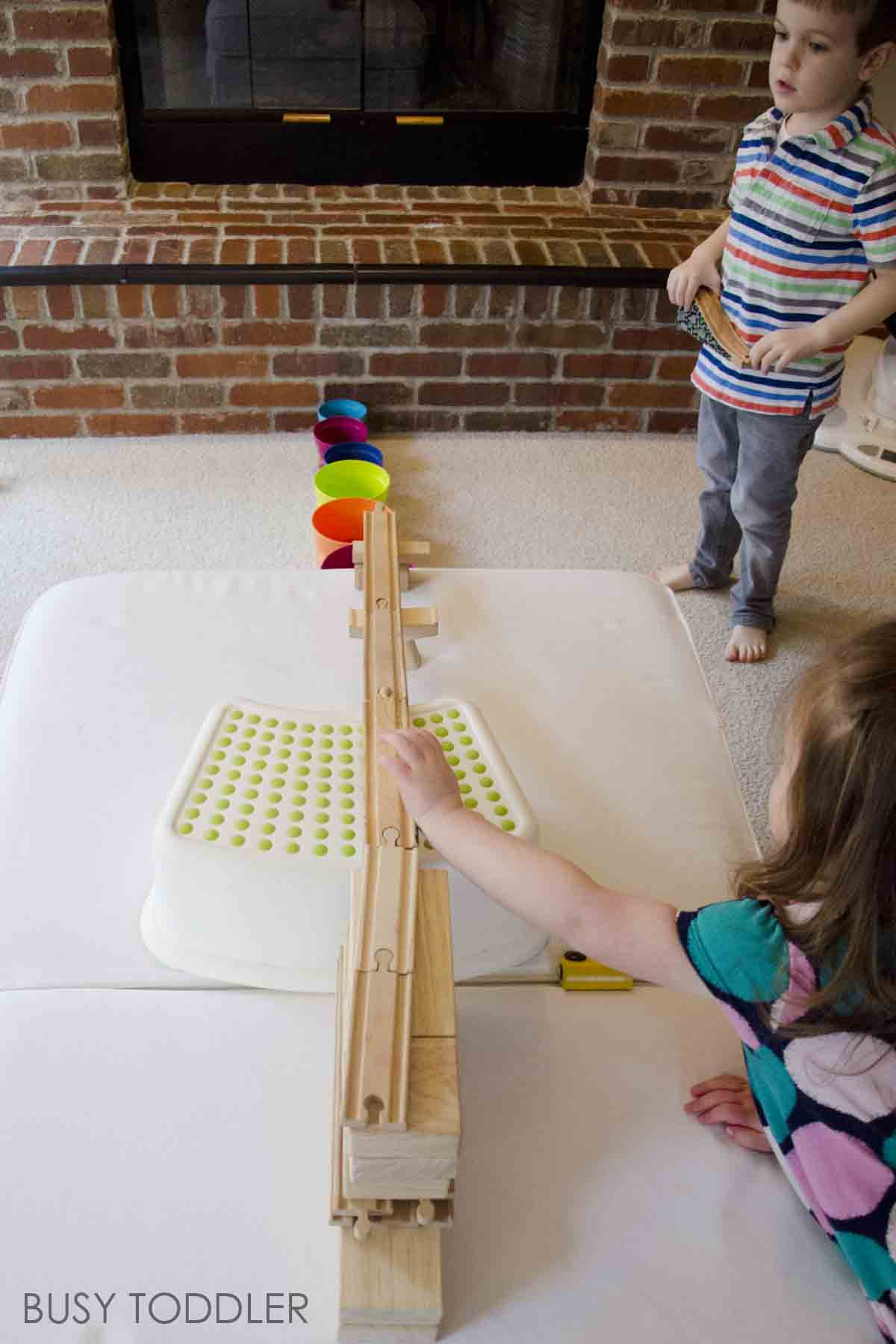 TRAIN TRACK SKEE BALL: We loved the book Old Tracks, New Tricks and it inspired this wooden train track activity. Making a fun indoor activitTRAIN TRACK SKEE BALL: We loved the book Old Tracks, New Tricks and it inspired this wooden train tracks activity. Making a fun indoor activity that toddlers and preschoolers will love. This STEM activity was so much fun! y that toddlers and preschoolers will love. This STEM activity was so much fun!