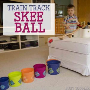 TRAIN TRACK SKEE BALL: We loved the book Old Tracks, New Tricks and it inspired this wooden train track activity. Making a fun indoor activity that toddlers and preschoolers will love. This STEM activity was so much fun!
