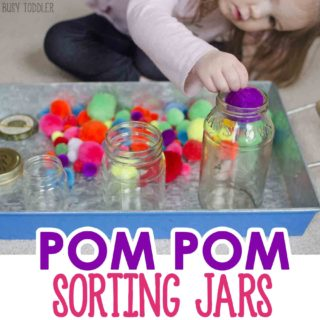 POM POM SORTING JARS: An easy toddler activity with pom pom balls. Toddlers will love this simple math activity that's perfect for indoor learning. Busy Toddler.
