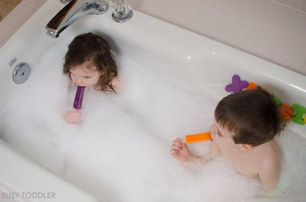 POPSICLE BATH: the best toddler activity ever! This is the one toddler activity you need to be doing at home. The perfect bath time activity for grumpy or sick toddlers. Busy Toddler.