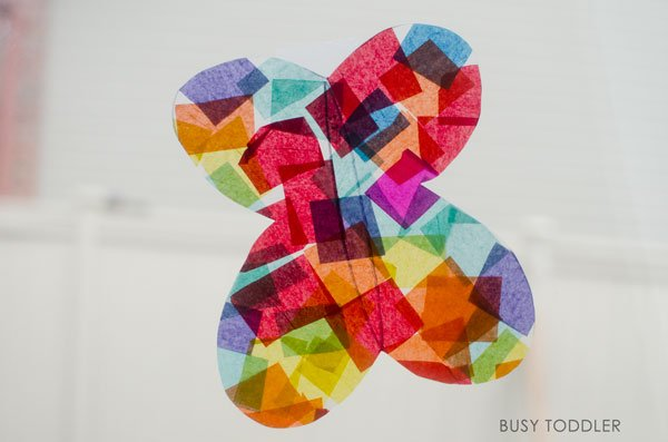 EASY BUTTERFLY CRAFT - what a fun, quick and easy art activity for toddlers and preschoolers; they will love this springtime butterfly art project; make an easy butterfly suncatcher. Busy Toddler