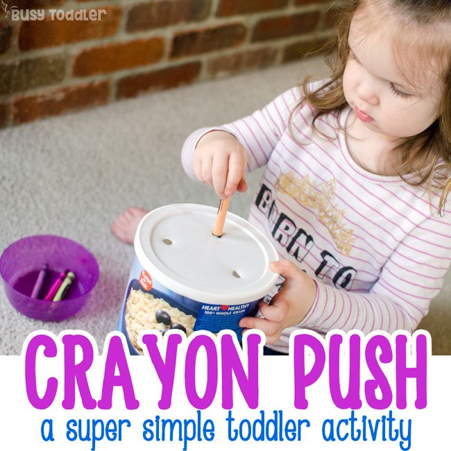CRAYON PUSH: A quick and easy toddler activity that's so simple to make; a DIY toddler activity; a fun fine motor skills activity for toddlers; a rainy day activity for toddlers; easy activity for toddlers; quick activity - Busy Toddler
