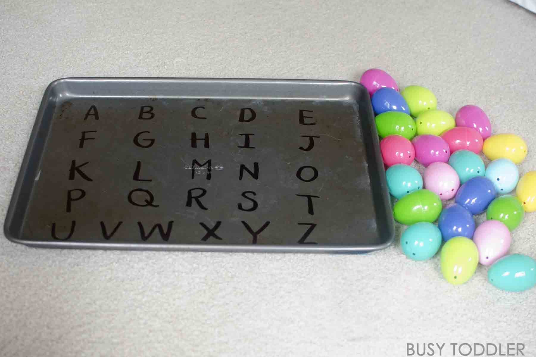 Alphabet Easter Activity: These alphabet filled Easter eggs make for one awesome toddler Easter activity. You will love this easy toddler activity from the A Very Toddler Easter series. A great toddler literacy activity.