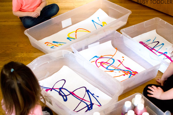 EASTER EGG ROLL & PAINT: An easy Easter Art Activity for toddlers and preschoolers. Kids will love this fun indoor activity using plastic Easter eggs. A simple process art activity for toddlers. Busy Toddler.