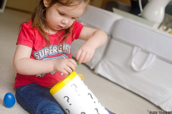 MYSTERY BOX: A quick and easy DIY game; a fun toddler sensory activity; an easy indoor activity for toddlers; five senses activity from Busy Toddler