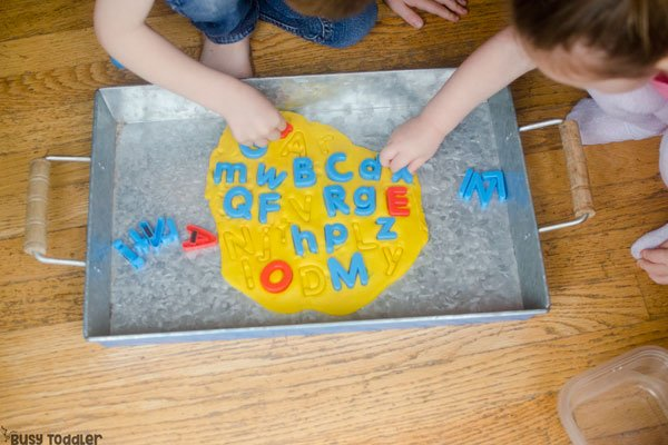 ABC PLAY DOUGH PUZZLE: What a great quick and easy alphabet activity for toddlers and preschoolers; a great ABC activity; a fun DIY puzzle; a rainy day activity for toddlers from Busy Toddlers