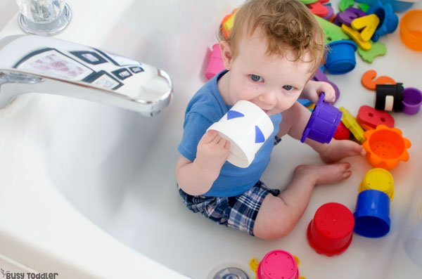 DRY BATH: An easy baby activity that's perfect for the bathroom; babies love this quick and easy activity; an easy way to entertain a baby from Busy Toddler