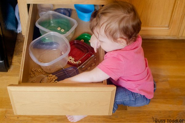 CHEERIOS FIND: A fine motor skills baby activity that's so quick and easy to set up; an easy baby activity; a quick baby activity from Busy Toddler