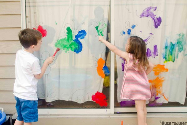 GIANT WINDOW PAINT: An easy outdoor art activity for toddlers; kids will love this fun way to paint; a quick and easy art activity; A diy coloring page art project from Busy Toddler
