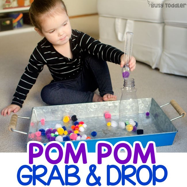 POM POM GRAB AND DROP ACTIVITY: A super easy toddler activity that's so fast to set up; a simple toddler activity; fine motor skills; easy indoor activity; pom pom balls activity; quiet time activity from Busy Toddler