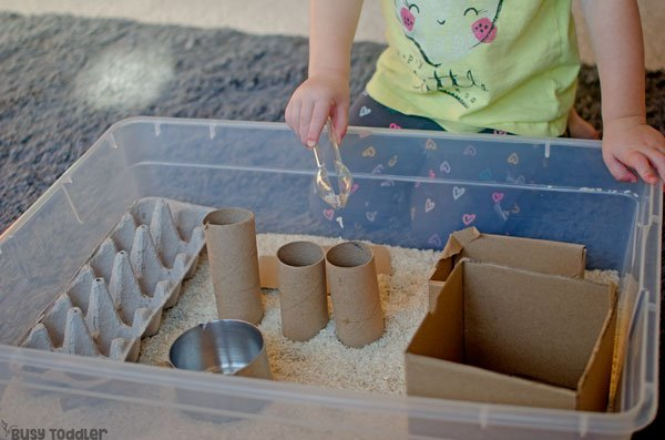 RECYCLED SENSORY BIN: A quick and easy toddler activity; toddlers will love this easy sensory bin activity; fun indoor activity; simple activitiy from Busy Toddler