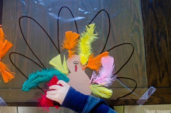 MAKE A STICKY TURKEY:  This easy kids Thanksgiving craft is perfect for celebrating Thanksgiving; an easy preschool thanksgiving activity; an easy toddler thanksgiving activity; easy indoor art activity from Busy Toddler