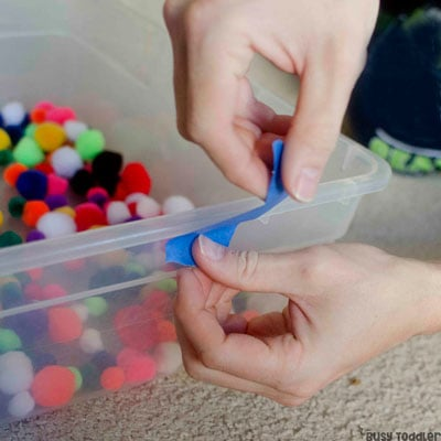 POM POM RAMPS: A quick and easy toddler activity; a toddler pom pom activity; easy indoor activity perfect for rainy days; rainy day toddler activity from Busy Toddler