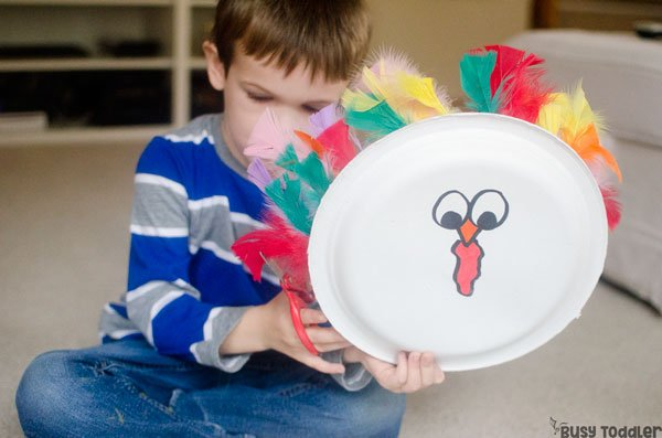 TURKEY HAIRCUT ACTIVITY: Give a turkey a haircut in this fun activity; easy toddler activity; easy Thanksgiving activity for preschoolers; preschool scissors activity; introducing scissors to preschoolers from Busy Toddler