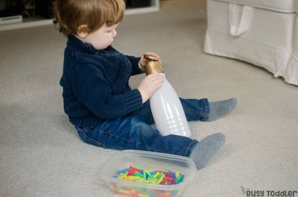 STRAW DROP:  A super easy toddler activity! A great activity for babies; an easy indoor activity; fine motor skills activity; diy game activity from Busy Toddler