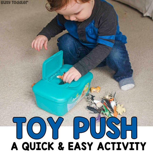 SIMPLE TOY PUSH ACTIVITY: Check out this quick and easy baby activity; a quick and easy toddler activity; easy indoor activity; fine motor skills activity; diy activity; rainy day activity from Busy Toddler