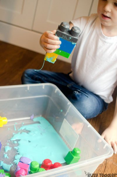 BLOCKS AND GAK: Check out this super easy sensory activity that's perfect for toddlers and preschoolers; a toddler sensory activity; a messy sensory activity; oobleck activity; activity for preschoolers; blocks activity; indoor activity from Busy Toddler