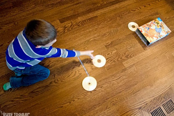 CD AIR HOCKEY: A quick and easy activity for toddler winter games; an easy indoor activity; a gross motor skills activity for toddlers and preschoolers from Busy Toddler