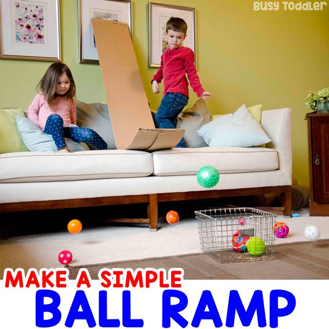 DIY BALL RAMP: Check out this awesome ski jump ball activity; a DIY ball ramp from a cardboard box; easy indoor activity; gross motor activity; using recycled items; quick and easy activity; cardboard box activity from Busy Toddler