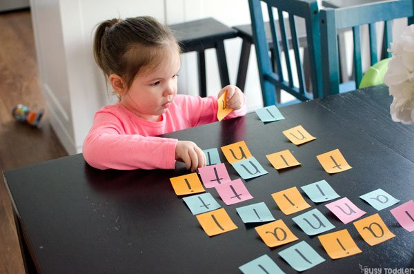 POST-IT NAMES: An easy name recognition activity; an easy learning activity; alphabet activity for toddlers; preschool alphabet activities; quick and easy activity; easy kids activity from Busy Toddler