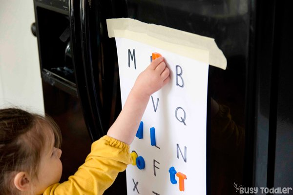 FRIDGE MAGNET MATCHING: This is an easy dinner prep activity that you can do while you cook! An easy alphabet activity; a fun learning activity; matching activity; easy preschool activity; easy toddler activity from Busy Toddler