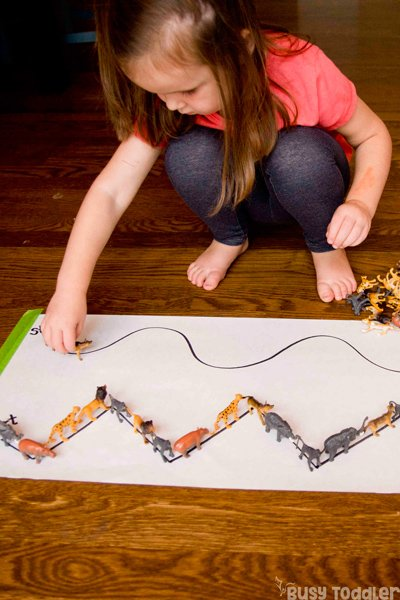ANIMAL PARADE: Take the animals on a walk in this simple line-up activity; a great fine motor skills activity; spatial awareness activity; easy indoor activity; rainy day activity from Busy Toddler