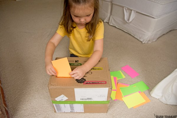 SORTING DROP BOX:  A quick and easy toddler activity; drop box activity; indoor activity; rainy day activity; preschool drop box; preschool sorting box from Busy Toddler
