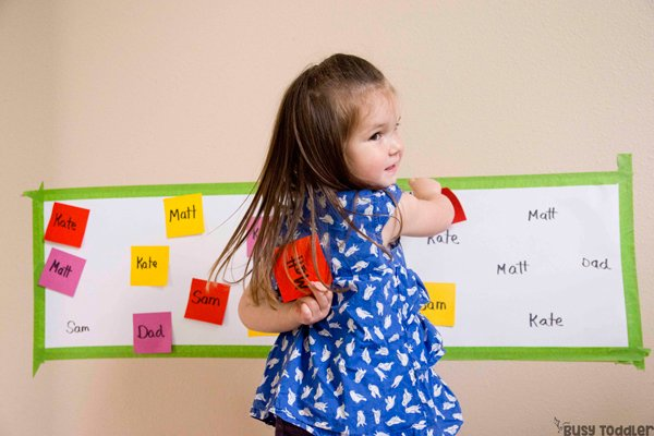 POST-IT NAME MATCH:  A simple name recognition activity that's perfect for toddlers and preschoolers; make a fun name activity; easy indoor activity; quick and easy activity; learning activity; preschool activity from Busy Toddler