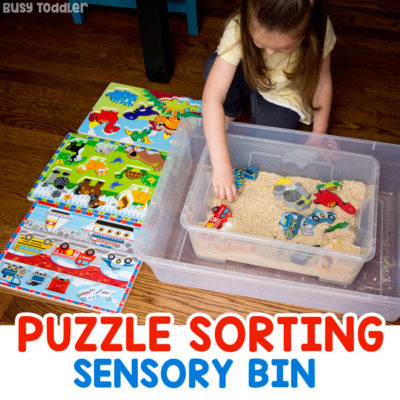 PUZZLE SORTING SENSORY BIN: A quick and easy toddler activity; an indoor activity; rainy day activity; rice sensory bin; puzzle activity; preschool activity; easy preschool activity from Busy Toddler