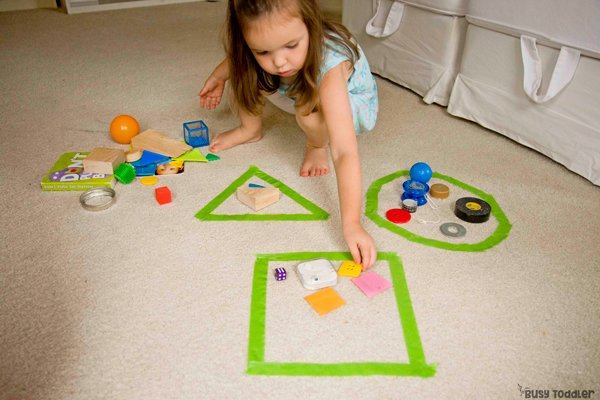 SHAPE SORTING: A quick and easy way to learn about shapes; shapes activity; math activity for toddlers; math activity for preschoolers; teaching shapes; attributes of shapes; real world shapes; indoor learning activity from Busy Toddler