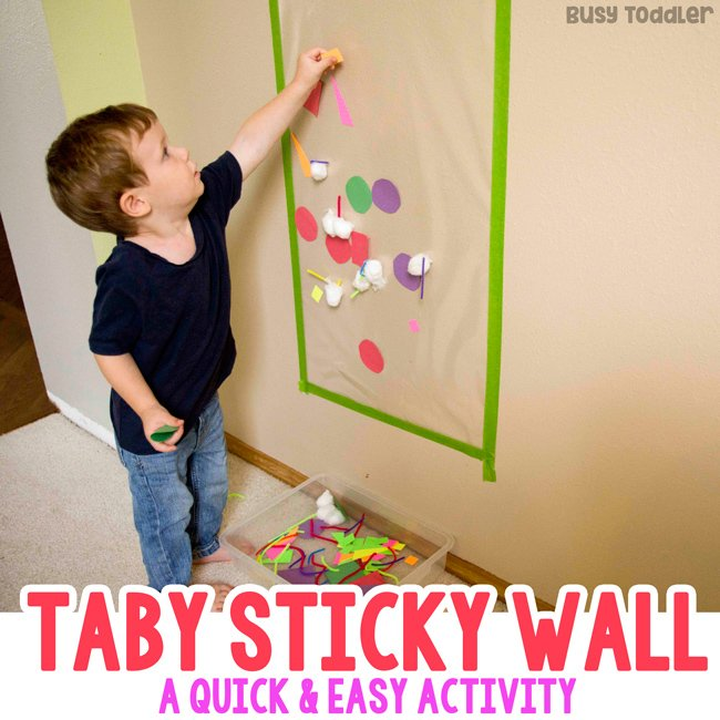 TABY STICKY WALL: A quick and easy activity for a one year old; toddler fine motor activity; easy activity; indoor activity; rainy day activity from Busy Toddler